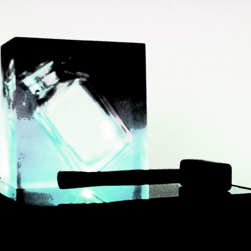 no contents (are you talking about art?). barattolo di vetro, resina, martello, base in legno, cm. 42 x 42 x 146. 1997